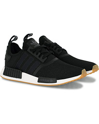 258e442a7dc adidas Originals NMD_R1 Running Sneaker Black