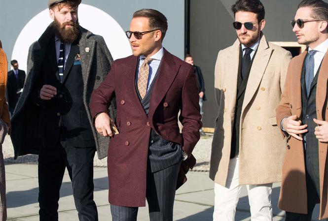 Fyra män som bär rock